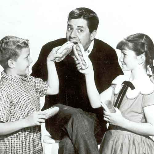 Jerry Lewis - Lewis, the prolific film and tv star and comedian enjoying hot dogs in the 1950s.